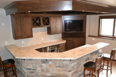 Wet Bar with Raised Snack Ledge and Entertainment Cabinet