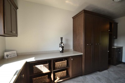 custom laundry room with shoe cabinet